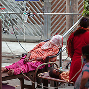 1 May 2021<br /> <br /> Indirapuram, Gazhiabad<br /> A womens body lies covered after she died at the free oxygen facility set up at the Sikh temple in Indirapuram, Gazhiabad.