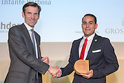 Ernesto Infante Barbosa of EcoCasa receiving its award from Mark Preston of Grosvenor . The 2015 Ashden Awards ceremony held at the Royal Geographical Society, London. UK.