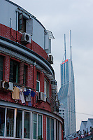 old apartments and new skyscrapers in Shanghai China