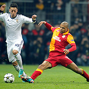 Galatasaray's Felipe Melo De Carvalho (R) and Real Madrid's Mesut Ozil (L) during their UEFA Champions League Quarter-finals, Second leg match Galatasaray between Real Madrid at the TT Arena AliSamiYen Spor Kompleksi in Istanbul, Turkey on Tuesday 09 April 2013. Photo by Aykut AKICI/TURKPIX