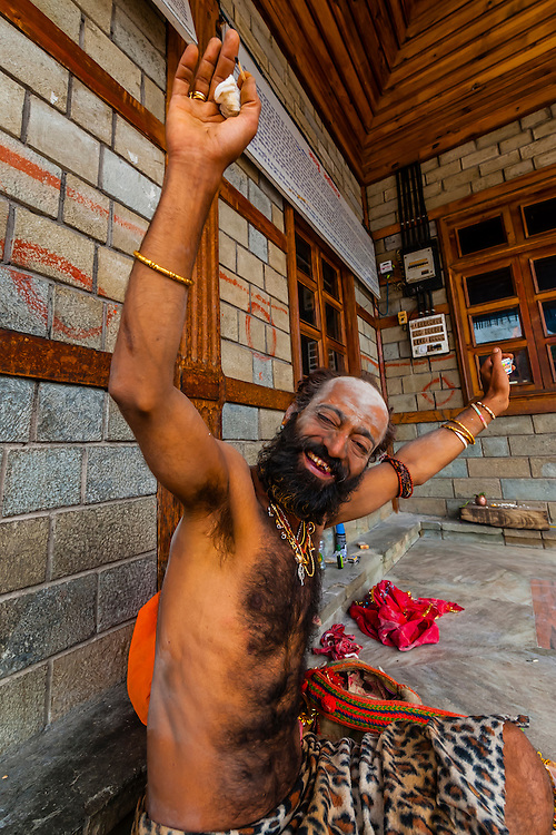 Saddhu (Holy man) smoking hash at a Hindu temple in Old Manali, Himachal Pradesh, India.