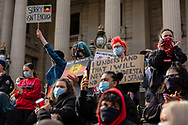 Protesters stand on the steps of Parliament House wearing facemasks and holding placards during a Black Lives Mater rally on 06 June, 2020 in Melbourne, Australia. This event was organised to rally against aboriginal deaths in custody in Australia as well as in unity with protests across the United States following the killing of an unarmed black man George Floyd at the hands of a police officer in Minneapolis, Minnesota. (Photo by Dave Hewison/ Speed Media)