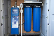 UV water filter and micron filters for harvested rainwater on Green home that is off the grid. Solar power and a rainwater harvesting system supply all the energy and water for this home in Los Angeles, California, USA