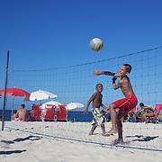 Young children play beach volleyball at Copacabana beach, Rio de Janeiro,  Brazil. 4th July 2010. Photo Tim Clayton..