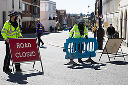 Windsor, UK. 17th April, 2021. Thames Valley Police officers close a road in preparation for the arrival of ceremonial guards at Windsor Castle for the funeral of the Duke of Edinburgh. The funeral of Prince Philip, Queen Elizabeth II's husband, is taking place at St George's Chapel in Windsor Castle, with the ceremony restricted to 30 mourners in accordance with current coronavirus restrictions.