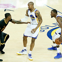 04 June 2017: Golden State Warriors forward Kevin Durant (35) drives past Cleveland Cavaliers guard Iman Shumpert (4) on a screen set by Golden State Warriors forward David West (3) during the Golden State Warriors 132-113 victory over the Cleveland Cavaliers, in game 2 of the 2017 NBA Finals, at the Oracle Arena, Oakland, California, USA.