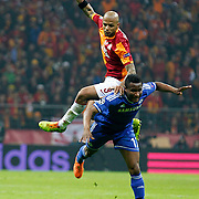 Galatasaray's Felipe Melo De Carvalho (B) and Chelsea's John Obi Mikel Doubtful (F) during their UEFA Champions League Round of 16 First leg soccer match Galatasaray between Chelsea at the AliSamiYen Spor Kompleksi in Istanbul, Turkey on Wednesday 26 February 2014. Photo by Aykut AKICI/TURKPIX