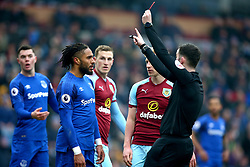 Everton's Ashley Williams receives a red card from Referee Chris Kavanagh during the Premier League match at Turf Moor, Burnley.