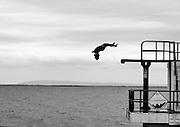 Katie McAnena dives from the tower in Blackrock, Galway during the Galway Sea Festival sponsored by the Gathering. Picture:Andrew Downes