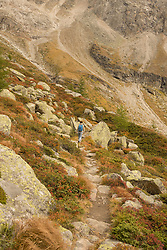 Rear view of a mature hiker climbing on mountain, Austrian Alps, Zirmsee, Carinthia, Austria