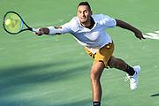 NICK KYRGIOS hits a service return at the Rock Creek Tennis Center.