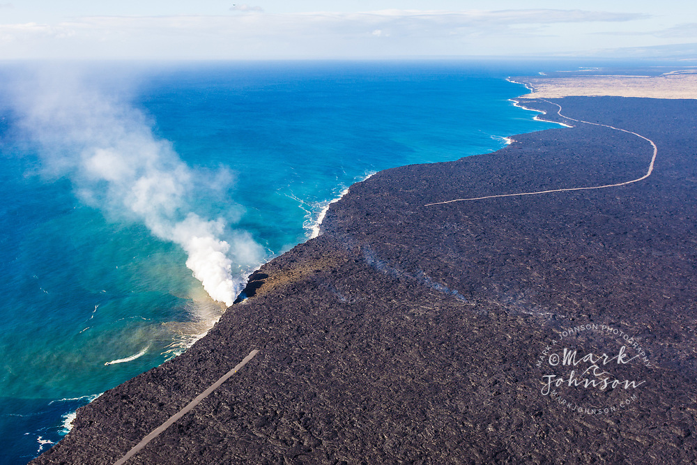 Aerial photo of the smoke plume from the lava pouring into the sea at Kamokuna, Hawaii Volcanoes National Park, Big Island, Hawaii