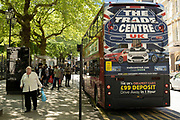 Trade Centre UK bus advertisement as the coronavirus restrictions continue and the government is about to announce an extension to the original freedom day planned for June, slowing the process of easing, more and more people begin to come to the city centre on 15th June 2021 in Birmingham, United Kingdom. After months of lockdown, the first signs that life will start to get back to normal continue, with more people enjoying the company of others in public, while uncertainty continues for a projected further month, which is being dubbed The final push.