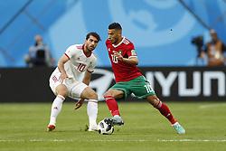 (l-r) Karim Ansarifard of IR Iran, Younes Belhanda of Morocco