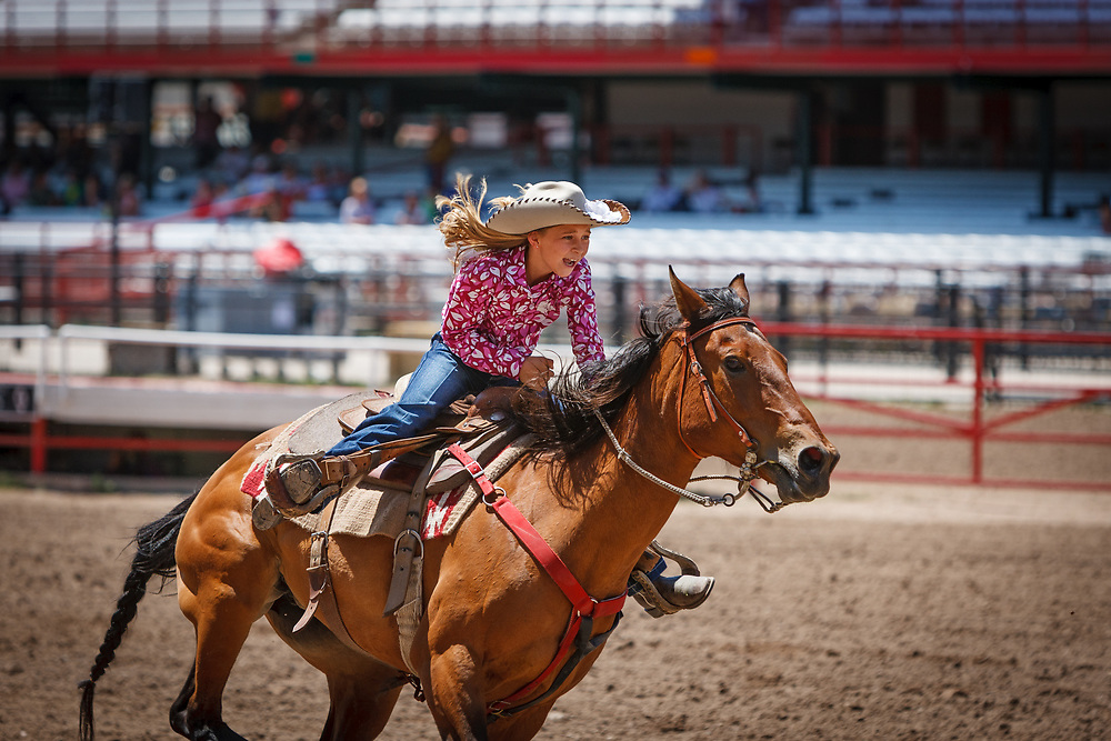 CONNER MORDAHL performs in the Kids Barrel Racing competition during Cheyenne Frontier Days, the world's largest outdoor rodeo.