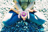 Coastal flower in a yoga hand mudra.