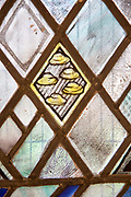 Church of Saint Andrew, Little Glemham, detail of stained glass window five barley loaves by Margaret Edith Aldrich Rope 1929