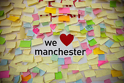 © Licensed to London News Pictures . 14/08/2011 . Manchester , UK . A wall in Manchester's Arndale Shopping Centre on which people post their own responses and feelings about looting and rioting in the city . Disorder spread to Manchester during a 4th night of rioting and looting on 9th August 2011 , following a protest against the police shooting of Mark Duggan in Tottenham . Photo credit : Joel Goodman/LNP
