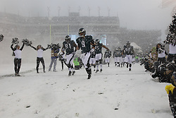 Philadelphia Eagles quarterback Nick Foles #9 enters the field with the team before the NFL game between the Detroit Lions and the Philadelphia Eagles on Sunday, December 8th 2013 in Philadelphia. (Photo by Brian Garfinkel)