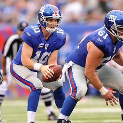 Quarterback Eli Manning #10 receives the snap from center Adam Koets #61 both of the New york Giants during second half NFL football action between the New York Giants and Tennessee Titans at New Meadowlands Stadium in East Rutherford, New Jersey. The Titans defeated the Giants .