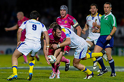 Exeter Chiefs Full Back (#15) Luke Arscott is tackled during the second half of the match - Photo mandatory by-line: Rogan Thomson/JMP - Tel: Mobile: 07966 386802 20/10/2012 - SPORT - RUGBY - Sandy Park Stadium - Exeter. Exeter Chiefs v ASM Clermont Auvergne - Heineken Cup Round 2