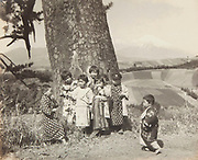 """Okada Koyo<br /> Elementary students from the village of Mitsuya Shinden on the Tokaido Road<br /> Date: 1940s<br /> <br /> One of the very few Okada images of Mt. Fuji with the primary focus being people.<br /> <br /> Description: Rare image by Okada showing people prominently posed in the foreground. This photo was taken at the village of Mitsuda Shingen, in Shizuoka Prefecture, which is on the old and historic Tokaido Road. In the book """"Mt. Fuji"""", by Okada Koyo, Hobundo Publishing, Tokyo, 1964, he writes about this location:<br /> <br /> """"Mitsuya Shinden is a village on the highway between Mishima and Hakone about 20 minutes by car from Mishima. If you turn left off the highway and go beyond the farmhouses that line it, you come to the broad fields seen here. Since the place is conveniently located, I usually go there about once a month, and the rhythmical changes in the appearance of the fields fascinates me"""".<br /> <br /> Vintage or near vintage, double weight, gelatin silver print, with smooth semi-matte surface, unsigned.<br /> <br /> Condition: Good with some minor color shifts at the edges. There is also a small crease, about 10 mm in length in the lower left corner. The print comes matted in an archival mat board.<br /> <br /> Size: 10 1/4 in. x 8 1/4 in. (260 mm x 210 mm).<br /> <br /> Price: ¥150,000 JPY<br /> <br /> <br /> <br /> <br /> <br /> <br /> <br /> <br /> <br /> <br /> <br /> <br /> <br /> <br /> <br /> <br /> <br /> <br /> <br /> <br /> <br /> <br /> <br /> <br /> <br /> <br /> <br /> <br /> <br /> <br /> <br /> <br /> <br /> <br /> <br /> <br /> <br /> <br /> <br /> <br /> <br /> <br /> <br /> <br /> <br /> <br /> <br /> <br /> <br /> <br /> <br /> <br /> <br /> <br /> <br /> <br /> <br /> <br /> <br /> <br /> <br /> <br /> <br /> <br /> <br /> <br /> <br /> <br /> <br /> <br /> <br /> <br /> <br /> <br /> <br /> <br /> <br /> <br /> <br /> <br /> <br /> <br /> ."""