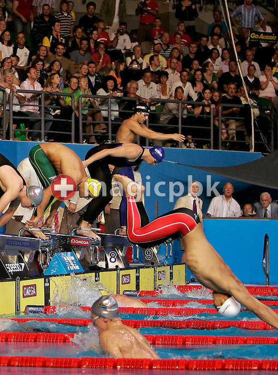 Andrew LAUTERSTEIN (green legskins) of Australia's winning team starts to swim the butterfly leg in the Men's 4 x 100m Medley Relay Final in the Susie O'Neill pool at the FINA Swimming World Championships in Melbourne, Australia, Sunday 1 April 2007. (Photo by Patrick B. Kraemer / MAGICPBK)
