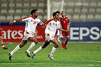 01/03/04 - ABU DHABI - UAE - Under 23 - U23 - PRE OLYMPIC GAMES - U.A.E. Vs. LEBANON - <br />Here uae PLAYER N*9 RAMI YASLAM MOHAMMED celebrating hids goal with N*25 MAHAMMAD JUMA.<br />© Gabriel Piko/ Piko-Press