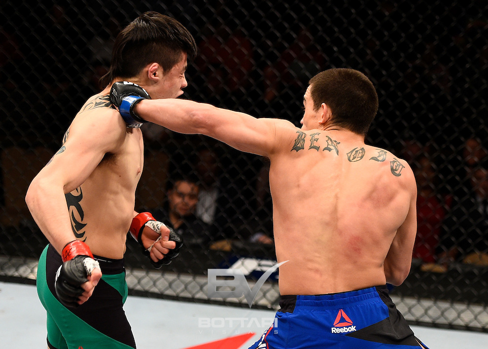 LAS VEGAS, NV - DECEMBER 03:  (R-L) Ryan Benoit punches Brandon Moreno of Mexico in their flyweight bout during The Ultimate Fighter Finale event inside the Pearl concert theater at the Palms Resort & Casino on December 3, 2016 in Las Vegas, Nevada. (Photo by Jeff Bottari/Zuffa LLC/Zuffa LLC via Getty Images)