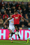 Marcus Rashford  of Manchester United © breaks away from Angel Rangel of Swansea city. .EFL Carabao Cup 4th round match, Swansea city v Manchester Utd at the Liberty Stadium in Swansea, South Wales on Tuesday 24th October 2017.<br /> pic by  Andrew Orchard, Andrew Orchard sports photography.
