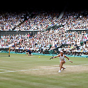 LONDON, ENGLAND - JULY 13: A general view of Johanna Konta of Great Britain in action against Venus Williams of the United States in the Ladies Singles Semi Final match during the Wimbledon Lawn Tennis Championships at the All England Lawn Tennis and Croquet Club at Wimbledon on July 13, 2017 in London, England. (Photo by Tim Clayton/Corbis via Getty Images)