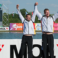 Stefan Holtz (R) and Tomasz Wylenzek (L) from Austria celebrate their victory in the C2 Men Canoe 1000m Final of the 2011 ICF World Canoe Sprint Championships held in Szeged, Hungary on August 20, 2011. ATTILA VOLGYI