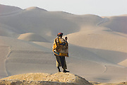 A Northern Alliance soldier overlooks dunes close to the outskirts of Kunduz.