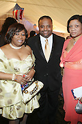 l to r: Sybil Chester, Roland Martin and Collette Clark at the The Radio One Inaugural Celebration 2009 Hennessey VIP Lounge Salute held at Lincoln Theater in Washington, DC on January 17, 2009..CATHY HUGHES, RADIO ONE FOUNDER AND CHAIRPERSON had a Hometown Inaugural Salute to President Barack Obama and Tom Joyner at the Lincoln Theater in Washington DC. Hennessy hosted celebrities and guests in a branded Hennessy lounge where Tatiana Ali interviewed celebrities about their feelings toward the Barack Obama Presidency. Celebrities in attendance included Jamie Foxx, Alonzo Morning, Eddie Levert, T. D. Jakes, Rev. Al Sharpton, Jackie Reid, Roland Martin, Dick Gregory, Raheem DaVaughn, Bow Bow, and more. Hennessy presented a commemorative Hennessy 44 Bottle which was signed by numerous celebrities which will be auctioned to create 4 four-year scholarships via the Thrugood Marshall College Fund...