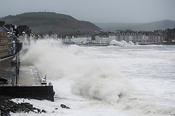 © London News Pictures. Aberystwyth, UK. 08/02/2016. Gale force winds from Storm Imogen, the 9th named storm of the winter, combined with the peak of the tide, create huge waves  lashing against  the promenade and sea defences at Aberystwyth on the west Wales coast.  Much of southern England and South Wales is subject to yellow and amber weather warnings, with the risk of damaging gusts of wind and powerful waves along coastal areas. Keith Morris/LNP<br /> <br /> <br /> photo © Keith Morris
