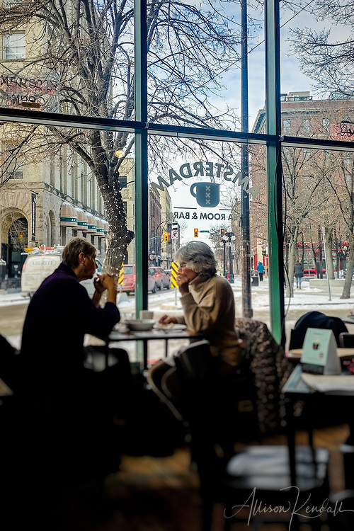 Two women enjoy lunch at the Amsterdam Tea Room on a winter afternoon, in the Exchange District of Winnipeg, Manitoba