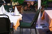 Outside seating terrasse at the restaurant. Restaurant Restoran Rondo on the Rondo Square Historic town of Mostar. Federation Bosne i Hercegovine. Bosnia Herzegovina, Europe.