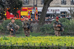 Military patrol outside the damaged Notre Dame Cathedral after a fire. French President Emmanuel Macron on Tuesday vowed to rebuild Notre Dame Cathedral, devastated by fire on Monday evening, within five years, calling on the French to remain united. In early Monday evening, a fire broke out in the famed cathedral. Online footage showed thick smoke billowing from the top of the cathedral and huge flames between its two bell towers engulfing the spire and the entire roof which both collapsed later. Paris, France, April 16, 2019. Photo by Samuel Boivin/ABACAPRESS.COM