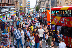 Edinburgh, Scotland, UK. 4th August  2021.  Edinburgh City Centre and Old Town busy this afternoon in warm sunny weather. Pic; The Royal Mile at Lawnmarket very busy with tourists shopping and sightseeing by foot and by city tour buses.  Iain Masterton/Alamy Live news.