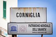 Town sign with UNESCO World Heritage designation , Corniglia, Cinque Terre, Liguria, Italy