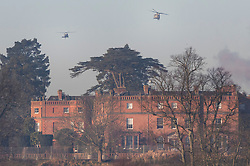 © Licensed to London News Pictures. 04/12/2019. Watford, UK. US Marine One helicopter (L) comes in to land behind The Grove Hotel where NATO leaders are meeting. World leaders are attending a series of events over the two day NATO summit which will mark the 70th anniversary of the alliance of nations. Photo credit: Peter Macdiarmid/LNP