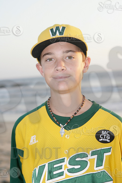 26 September 2011: #24 Hagen Danner 2011 Little League Baseball World Series Championship team portrait northside of the Huntington Beach Pier at sunset in Southern California.  Ocean View team WEST beat Hamamtsu City, Japan, 2-1, to become the seventh team from California to win the title on August 28, 2011 in South Williamsport, PA.