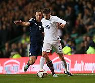 Scotland's Steven Whittaker tussles with England's Adam Lallana<br /> <br /> - International Friendly - Scotland vs England- Celtic Park - Glasgow - Scotland - 18th November 2014  - Picture David Klein/Sportimage