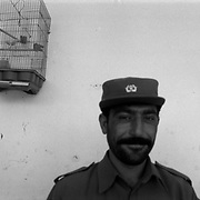 Aug 19, 2009 - Panjway District, Kandahar Province, Afghanistan - An Afghan Police officer (ANP) is seen in a Police Sub Station (PSS) with pet birds in the Panjway (aka Pajwaii) by the New District Center (NDC) just past Bazzar-e-Panjway  just west of Kandahar City, Afghanistan. .(Credit Image: © Louie Palu/ZUMA Press)