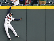 ATLANTA, GA - APRIL 18:  Centerfielder Ender Inciarte #11 of the Atlanta Braves catches a ball over the outfield wall to rob a home run from Philadelphia Phillies left fielder Scott Kingery #4 (not pictured) during the game at SunTrust Park on April 18, 2018 in Atlanta, Georgia.  (Photo by Mike Zarrilli/Getty Images). TOPPS NOW CARD.