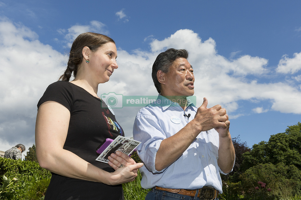 June 10, 2017 - Seattle, Washington, United States - Seattle, Washington: State Senator and mayoral candidate Bob Hasegawa appears with the Washington Education Association's Julianna Dauble at the Volunteer Park Pride Festival. The senator, a longtime labor and social justice activist from Seattle, has represented the 11th Legislative District since January 2013. (Credit Image: © Paul Gordon via ZUMA Wire)