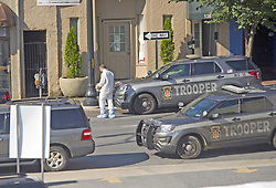 September 30, 2018 - Allentown, PA, USA - Police join members of the ATF and the FBI as they investigate North Hall Street (between Turner and Linden streets) in Allentown, Pa. around 10 a.m. Sunday, Sept. 30, 2018 after a fiery car explosion rocked the neighborhood on Saturday. (Credit Image: © Harry Fisher/Allentown Morning Call/TNS via ZUMA Wire)