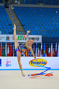 """Jerman Aja during ribbon routine at the International Tournament of rhythmic gymnastics """"Città di Pesaro"""", 11 April, 2015. Jerman Aja born 20 August 1999 in Ljubljana, is a Slovenian rhythmic gymnast.<br /> This tournament dedicated to the youngest athletes is at the same time of the World Cup."""