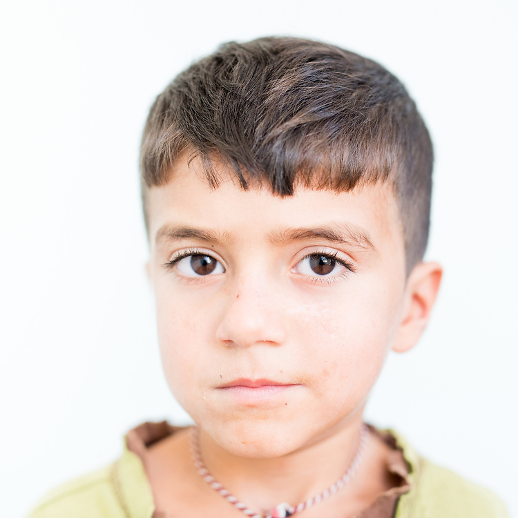 Dedlar Dakhil Khalaf a 9 year old Yazidi from Shingal town, northern Iraq.<br /> <br /> <br /> This is a series of portraits of Yazidi refugees who were stranded since April 2016 in Greece.  All of them survived the Yazidi Genocide by ISIS in August 2014 and most of them have lost family members.