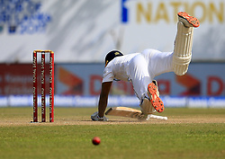 July 27, 2017 - Galle, Sri Lanka - Sri Lankan cricketer Danushka Gunathilaka loses his balance and falls down on his knees after facing a ball by Indian pacer Mohammed Shami(unseen) during  the 2nd Day's play in the 1st Test match between Sri Lanka and India at the Galle International cricket stadium, Galle, Sri Lanka on Thursday 27 July 2017. (Credit Image: © Tharaka Basnayaka/NurPhoto via ZUMA Press)